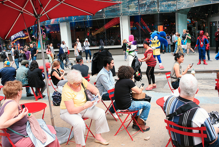 People sitting in Times Square